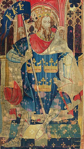 Tapestry showing Arthur as one of the Nine Worthies, wearing a coat of arms often attributed to him